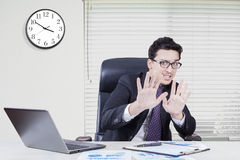 Fear businessman with hand gesture in office Royalty Free Stock Image