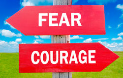 Fear and Courage. Way choice showing strategy change or dilemmas stock photo