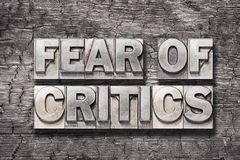 Fear of critics wood Royalty Free Stock Images