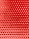 Red mettalic trypophobia. Fear of holes. my childhood phobia. representation in red mettalic a color of blood stock photo