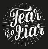 Fear Is A Liar. Hand drawn lettering. Nice grunge black and white vector t-shirt print Stock Images