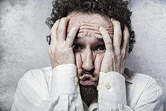 Fear, man in white shirt with funny expressions Stock Photography