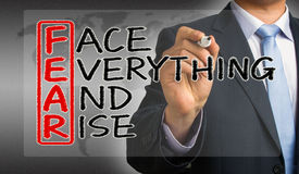 Fear means face everything and rise. Face everything and rise concept hand drawing by businessman vector illustration