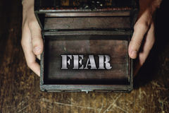 Fear. Men's hands into the box, which shows fear royalty free stock photos