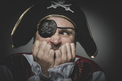 Fear pirate with eye patch and old hat with funny faces and expr Royalty Free Stock Photography