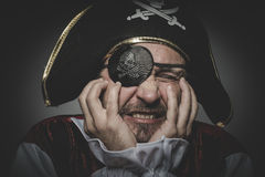 Fear pirate with eye patch and old hat with funny faces and expr Royalty Free Stock Image