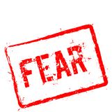 Fear red rubber stamp isolated on white. Fear red rubber stamp isolated on white background. Grunge rectangular seal with text, ink texture and splatter and Stock Photo