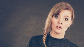 Blonde confused scared woman. Royalty Free Stock Images