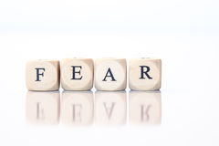 Fear, spelled with dice letters Stock Image