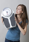Fear and stress of the weighting scale for teenagers Stock Photo
