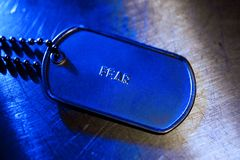 Fear tag. Metal necklace dog tag of fear royalty free stock photography