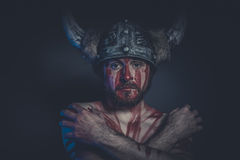 Fear, Viking warrior with a horned helmet and war paint on his f Royalty Free Stock Image