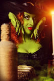 Fear woman. Close-up portrait of a fairy wicked witch in the wizarding lair. Magic. Halloween Stock Photos