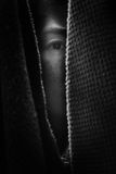 Fear woman hiding in closet. With shadow edge in white tone stock photography