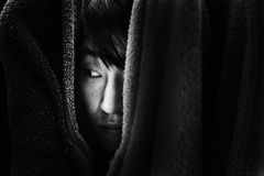 Fear woman hiding in closet Stock Photography