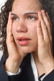 Fear at work. Businesswoman in her twenties scared and miserable at her job Stock Image