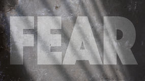 Fear Written on a concrete Wall Royalty Free Stock Photo