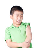 A fearful boy wearing green t-shirt look at his left side. Isolated royalty free stock image