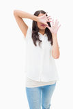 Fearful brunette covering her face Stock Images