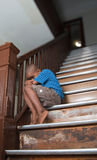 Fearful child. Sitting on a wooden staircase Stock Photography