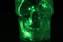 Fearful destroyed human skull in green light. Poison concept royalty free stock image