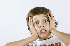 Fearful grimacing of boy on white Royalty Free Stock Images