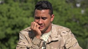 Fearful hispanic male soldier. A handsome adult hispanic man stock video