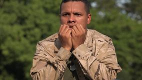 Fearful Hispanic Male Soldier Wearing Camo. A handsome adult hispanic man stock video
