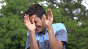 Fearful Male Hispanic Teenager. A handsome hispanic male teen stock footage