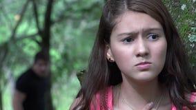 Fearful Teen Girl Hiding From Stalker. Stock video of fearful teen girl hiding stock video