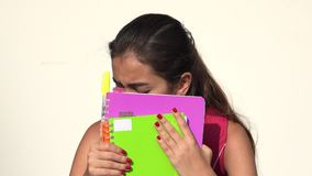 Fearful Or Timid Hispanic Female Teen Student. A young female hispanic teen stock video