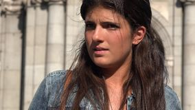 Fearful Woman Afraid And Suspicious. A young Spanish adult female stock video