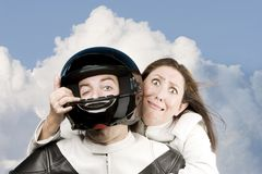 Fearful woman and man on a motorcycle Stock Image