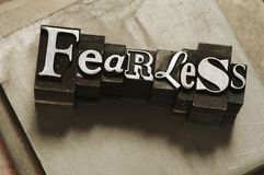 Fearless. The word Fearless photographed using vintage type characters on a metal background. See my other portfolio for more vintage type images stock photos