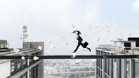 Fearless businessman overcoming difficulty. Mixed media . Mixed media Royalty Free Stock Images