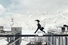 Fearless businessman overcoming difficulty. Mixed media . Mixed media Stock Images