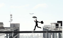 Fearless businessman overcoming difficulty. Mixed media . Mixed media Royalty Free Stock Photos