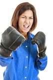 Fearless and furious young businesswoman in boxing concept Stock Image