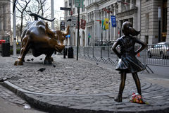 Fearless Girl. `The Fearless Girl` statue facing the Charging Bull in Lower Manhattan erected to honor International Women`s Day Stock Photos