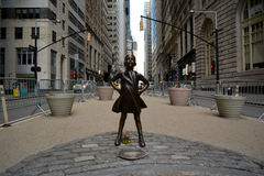 Fearless Girl. `The Fearless Girl` statue facing the Charging Bull in Lower Manhattan erected to honor International Women`s Day Royalty Free Stock Photo