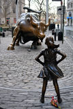 Fearless Girl. `The Fearless Girl` statue facing the Charging Bull in Lower Manhattan erected to honor International Women`s Day Stock Image