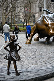 Fearless Girl. `The Fearless Girl` statue in Lower Manhattan erected to honor International Women`s Day Stock Photos