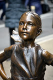 Fearless Girl. `The Fearless Girl` statue in Lower Manhattan erected to honor International Women`s Day Royalty Free Stock Images