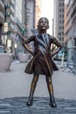 The Fearless Girl statue in Lower Manhattan, New York City. New York, USA - April 9, 2017 - The Fearless Girl statue in Lower Manhattan, New York City Stock Image