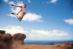 Fearless jump from cliff Royalty Free Stock Images