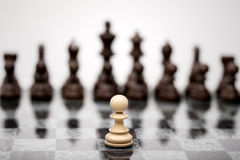 The fearless warior. A pawn on the chequer before the shapes stock images