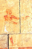 Feast. Servant preparing a feast, and placing the severed leg of a cow on a pile of food from the early new kingdom mortuary temple of Queen Hatshepsut at Thebes Stock Images