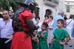 FEAST of BACCHUS .Burgos .SPAIN. FEAST of BACCHUS  .Legionary talking with children .BAÑOS DE VALDEARADOS . Burgos .Castilla y Leon .SPAIN Stock Photos