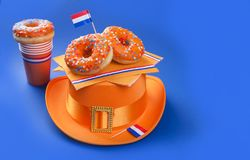 Feast day of the King. Orange accessories. Blue background. Place for text. Carnival in the spring in the Netherlands. Feast day of the King. Orange accessories Stock Photo