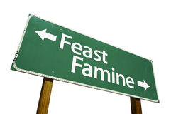Feast or Famine road sign. Isolated on a white background. Contains Clipping Path royalty free stock photography